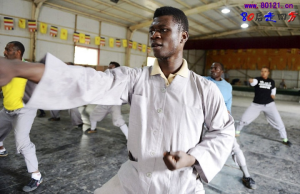 African Men Practicing Martial Arts