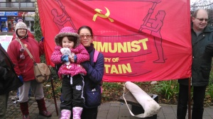 Gee & Mei-an in front of the Red Banner of Freedom