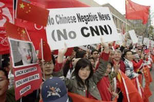 Chinese-Americans and others rally outside CNN's Hollywood office to demand the firing of commentator Jack Cafferty for calling China's goods